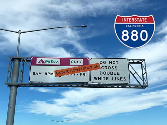 A freeway sign for the I-880 express lanes with Under Construction over it