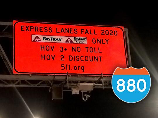"Orange FWY sign saying ""EXPRESS LANES FALL 2020; FasTrak ONLY; HOV 3+ NO TOLL; HOV 2 DISCOUNT; 511.org"